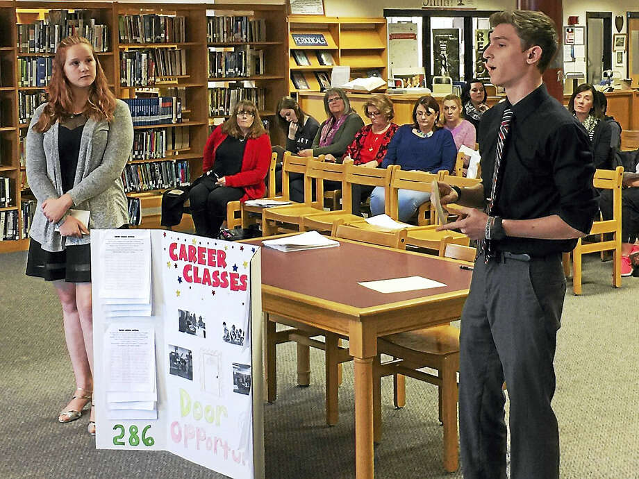 Ben Lambert - The Register Citizen  Torrington High School students Jacob Koenig and Kiara Dwan speak as part of a hearing held Thursday on the proposed Torrington school budget for the 2017-18 fiscal year. The students made their case for keeping career-focused classes in the district. Photo: Digital First Media