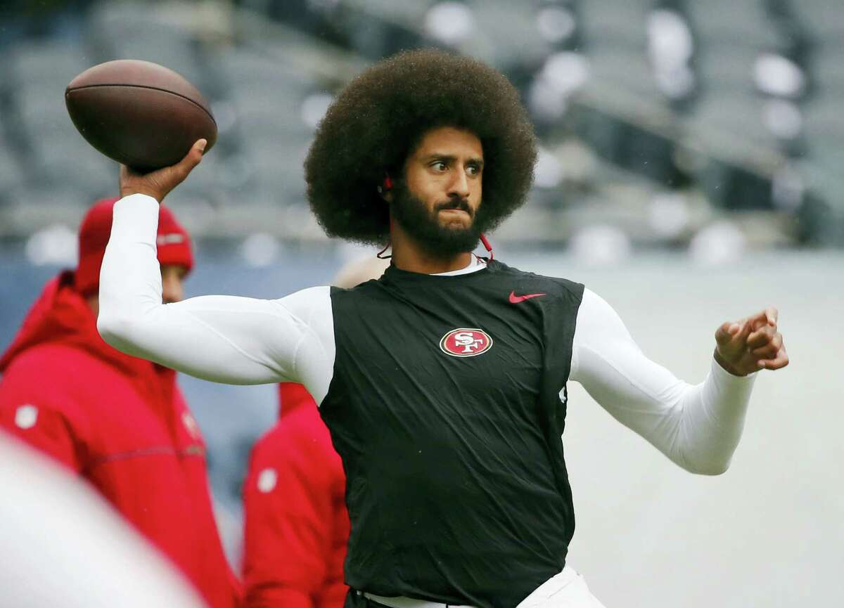 """In this Dec. 4, 2016 photo, San Francisco 49ers quarterback Colin Kaepernick warms up before an NFL football game against the Chicago Bears. Spike Lee said on Instagram Sunday, March 19, 2017, that it was """"fishy"""" that Kaepernick, now a free agent, hadn't been signed."""""""