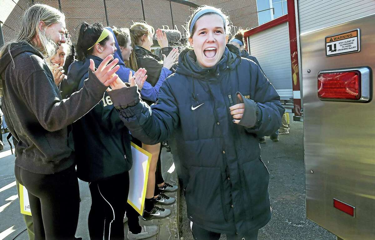 Quinnipiac guard Carly Fabbri walks through giving high fives to fans as the women's basketball team attends a Sweet 16 Send-Off Rally at the TD Bank Sports Center.