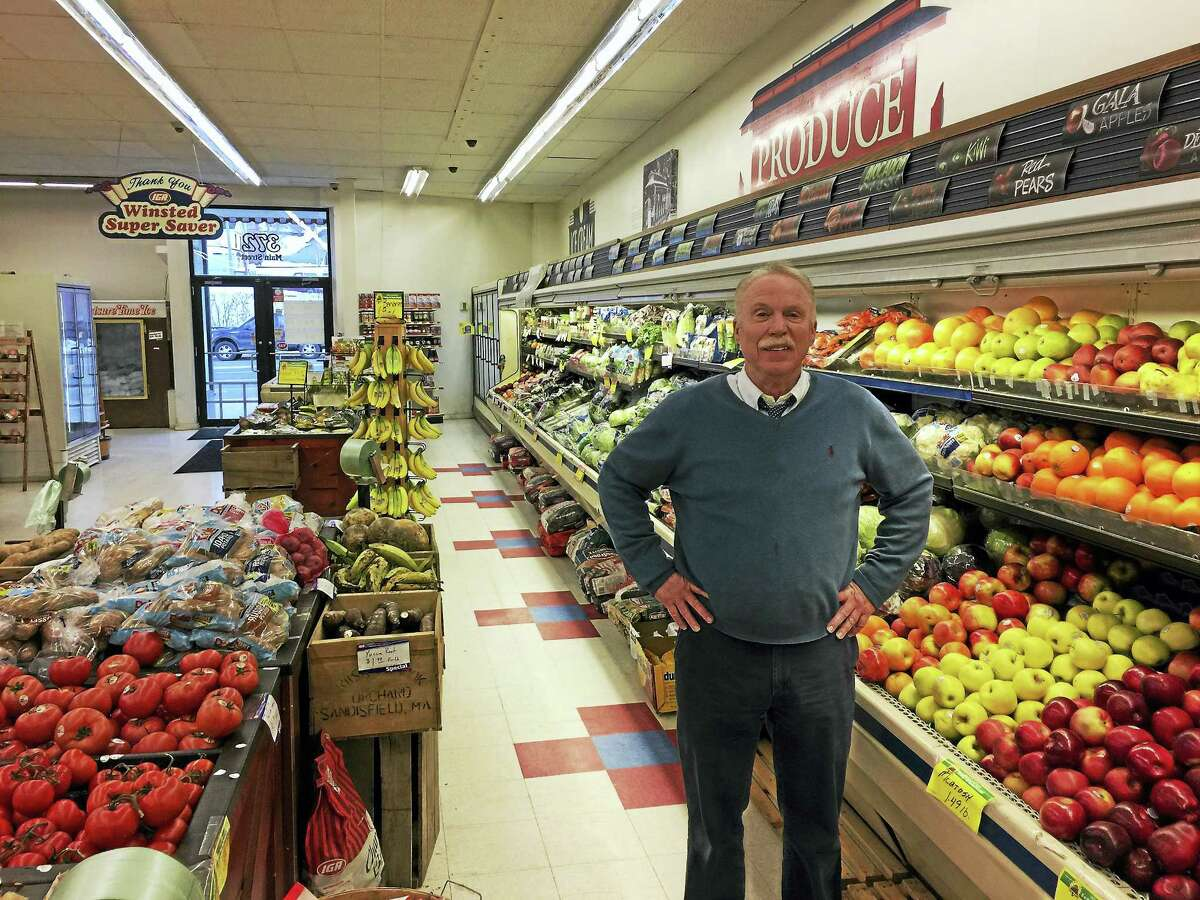 John Dwan, standing inside his store, the IGA Winsted Super Saver on Main Street, Winsted, wants to sell his property to Community Health & Wellness of Greater Torrington, and will retire after 36 years.