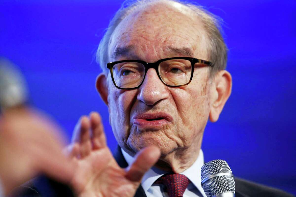 Former Federal Reserve Chairman Alan Greenspan answers a question by Ben White of Politico at the 2014 Fiscal Summit organized by the Peter G. Peterson Foundation in Washington, Wednesday, May 14, 2014. Lawmakers and policy experts discussed America's long term debt and economic future. (AP Photo)