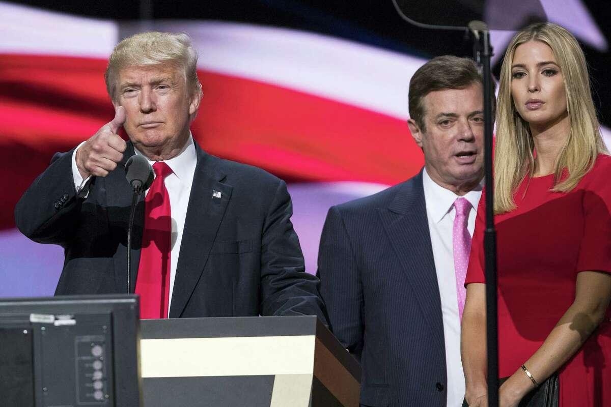 In this photo taken July 21, 2016, then-Trump Campaign manager Paul Manafort stands between the then-Republican presidential candidate Donald Trump and his daughter Ivanka Trump during a walk through at the Republican National Convention in Cleveland. Manafort, secretly worked for a Russian billionaire to advance the interests of Russian President Vladimir Putin a decade ago and proposed an ambitious political strategy to undermine anti-Russian opposition across former Soviet republics, The Associated Press has learned.