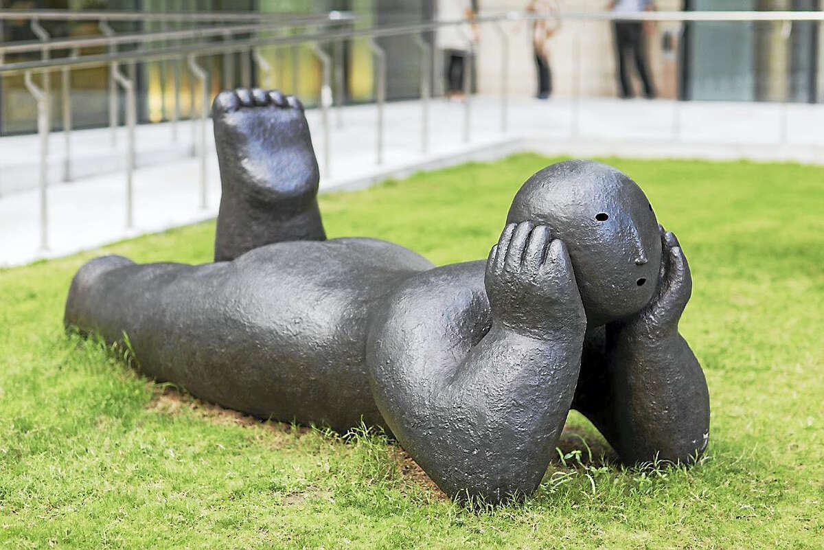 Joy Brown's bronze sculpture, Recliner with Head in Hands, is one of nine pieces now on display in New York City.