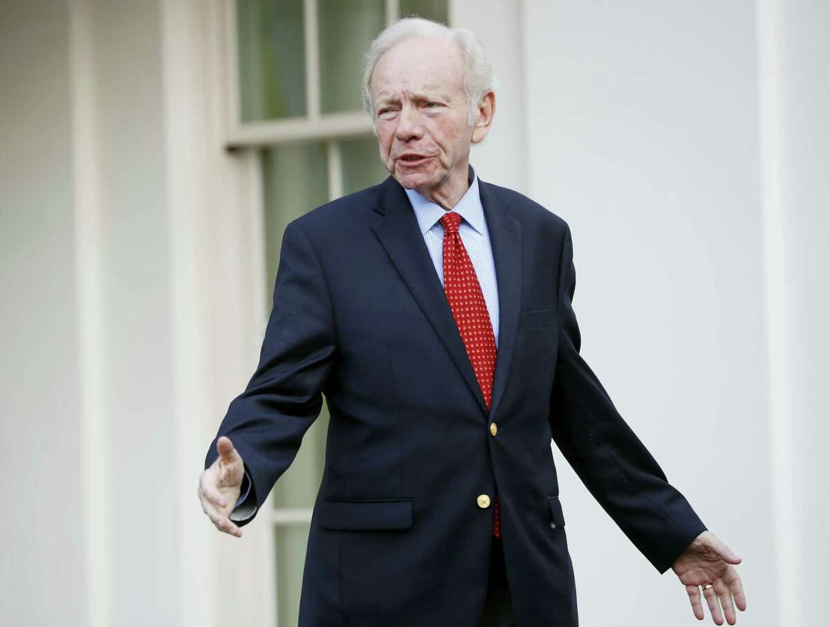 Former Connecticut Sen. Joe Lieberman leaves the West Wing of the White House in Washington, Wednesday, May 17.