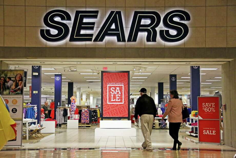 In this Feb. 8, 2017 photo, shoppers walk into a Sears store in Pittsburgh. Sears said that there is 'substantial doubt' that it will be able to remain in business. The company, which runs Kmart and its namesake stores, has struggled for years with weak sales. Photo: AP Photo — Gene J. Puskar, File  / Copyright 2017 The Associated Press. All rights reserved.