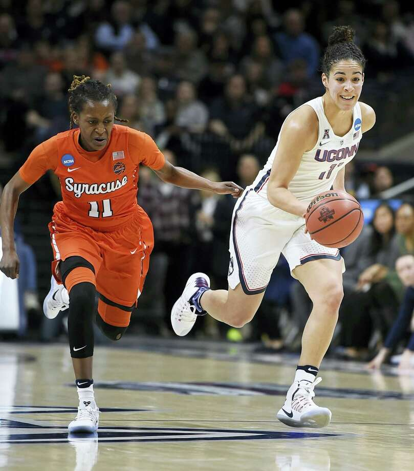 Connecticut's Kia Nurse dribbles as Syracuse's Gabby Cooper, left, defends, in the first half of a second-round game in the NCAA women's tournament Monday in Storrs. Photo: Jessica Hill — The Associated Press  / FR125654 AP