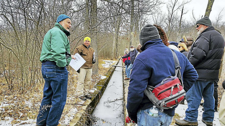 White Memorial Conservation Center research director James Fischer, center, and retired education director Jeff Greenwood, left, showed 29 visitors during a tour the canal that allowed the passage of ice blocks from Bantam Lake to the property's formerly prosperous ice house. Photo: N.F. Ambery — The Register Citizen