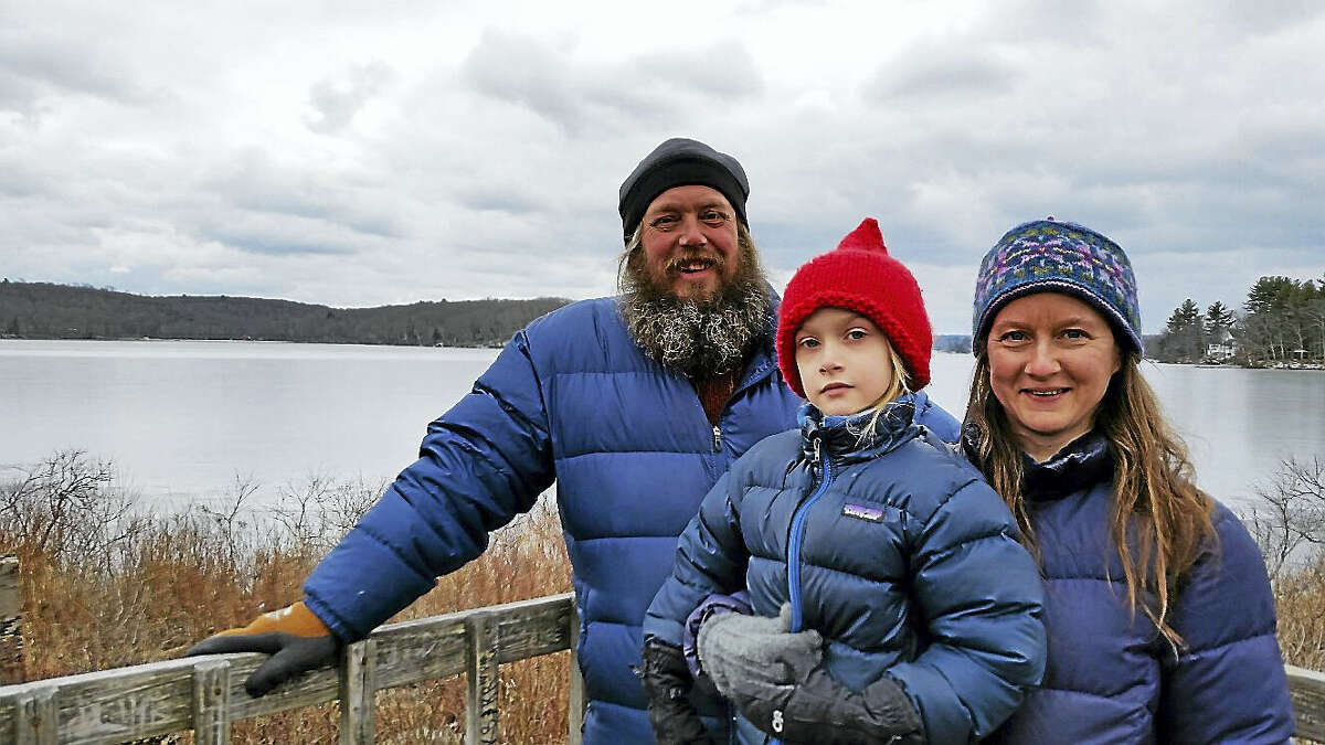 """New Hartford residents Chris and Amy Alvey with their son Noah, 5, stood on the elevated observation tower deck along Bantam Lake during a walk that was part of the seventh annual """"Local History and Practice of Ice Harvesting."""""""