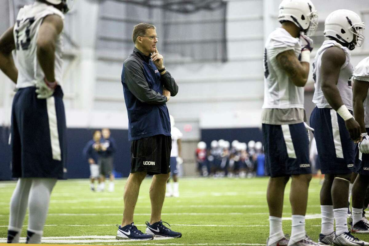 Connecticut coach Randy Edsall, center, watches during spring NCAA college football practice at the Mark R. Shenkman Training Center, Tuesday, March 21, 2017, in Storrs, Conn.