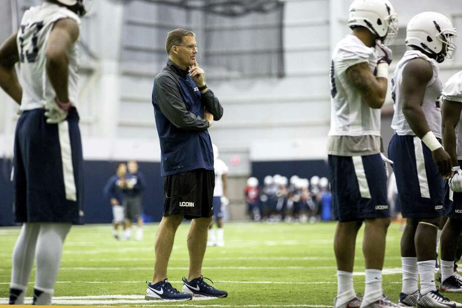 Connecticut coach Randy Edsall, center, watches during spring NCAA college football practice at the Mark R. Shenkman Training Center, Tuesday, March 21, 2017, in Storrs, Conn. Photo: Lauren Schneiderman - Hartford Courant Via AP  / Hartford Courant