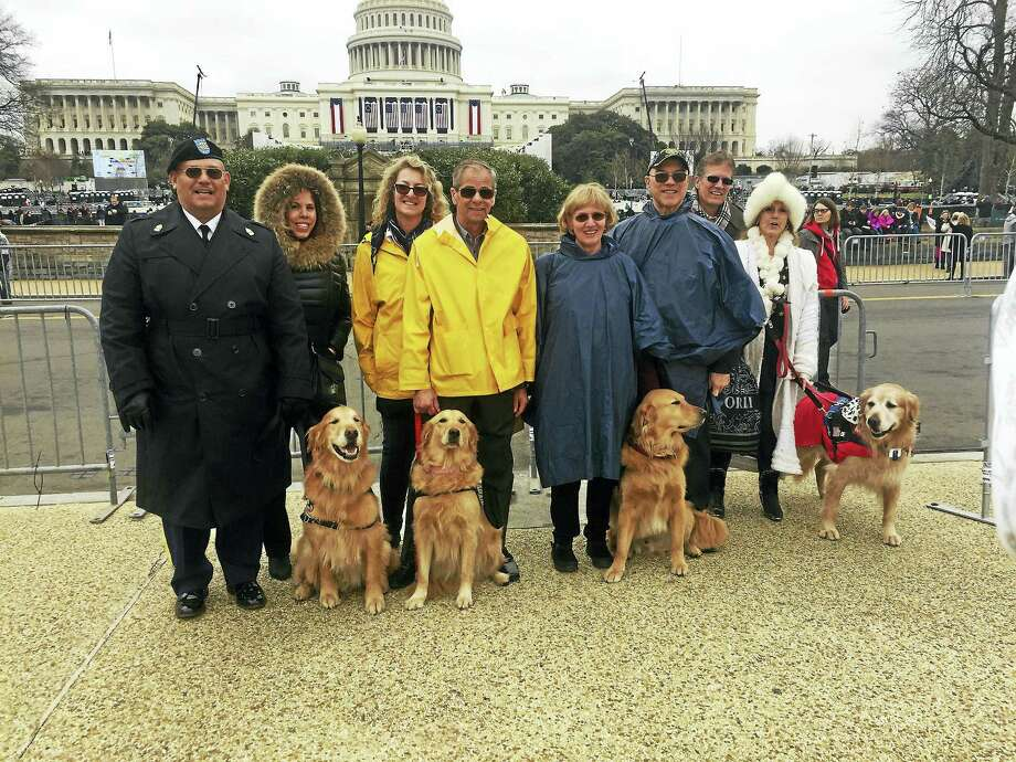 Sgt. Major Hector Torres (Ret. US Army) and his wife, Denise Torres, of Middletown N.Y., with retired Service Dog now ECAD Ambassador/Therapy Dog Tuesday; ECAD co-founders Lu and Dale Picard with Ambassador/Therapy Dog Tuna of Torrington/Winsted; Gwen Charles with her husband, Lt. Col. Tony Charles (Ret. U.S. Army) and his Service Dog Dozer of West Hartford; Carolyn Sires- Halaszynski and her husband Tom Halaszynski of New Haven, and Carolyn's Service Dog Blue. Photo: Contributed Photos — ECAD