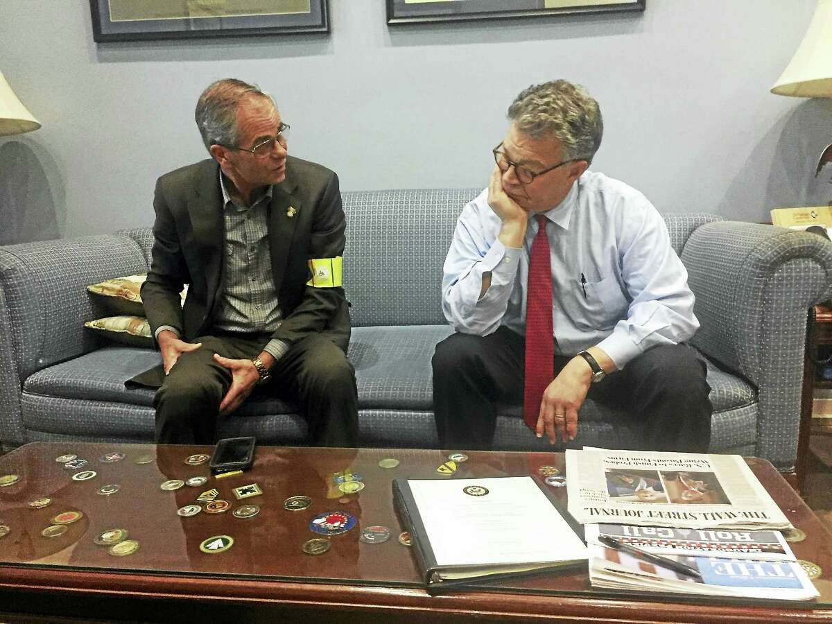 Dale Picard, co-founder of ECAD, Educated Canines Assisting with Disabilities, discusses the benefits of having Service Dogs placed with Veterans of the Armed Services with Senator Al Franken, (D-MN). Franken was a longtime friend of Capt. Luis Montalvan and his Service Dog Tuesday. The two were graduates of ECAD's Project HEAL Program that was designed specifically to pair Service Dogs with Veterans. ECAD representatives, including several Service Dogs and Veterans, were in DC for the Inauguration ceremony.