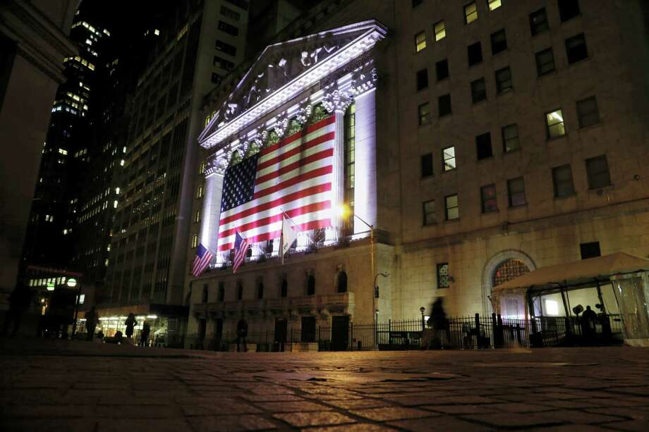 An American flag hangs on the front of the New York Stock Exchange. Photo: Peter Morgan — The Associated Press File  / Copyright 2017 The Associated Press. All rights reserved.
