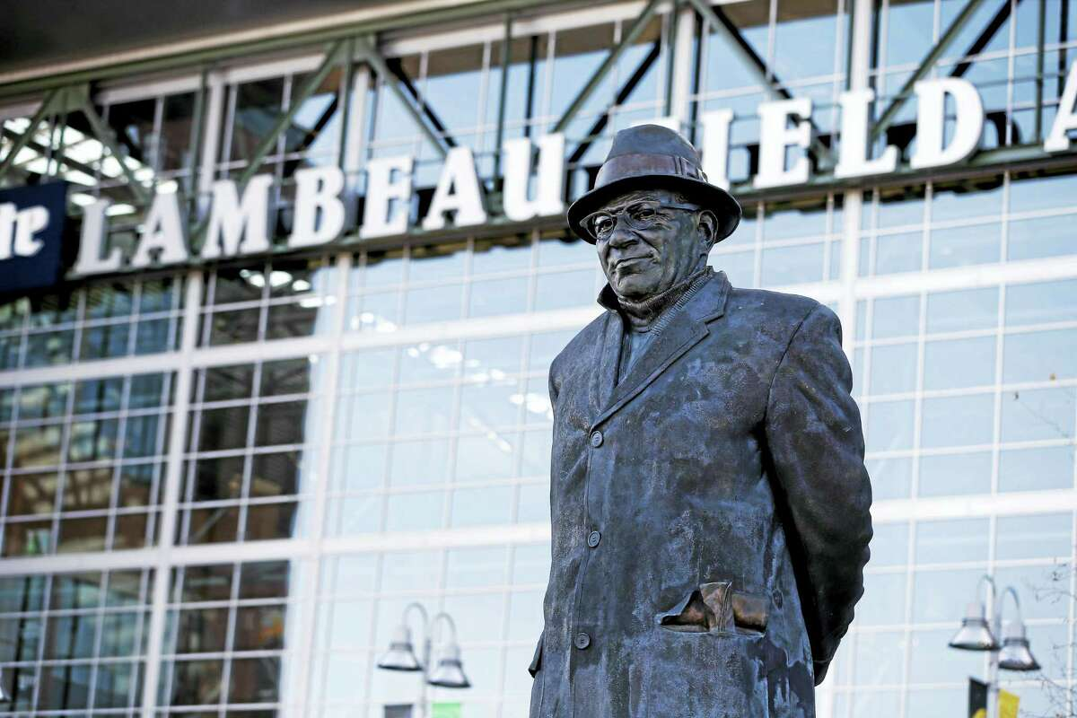 A statue of former Green Bay Packers head coach Vince Lombardi stands outside of Lambeau Field.