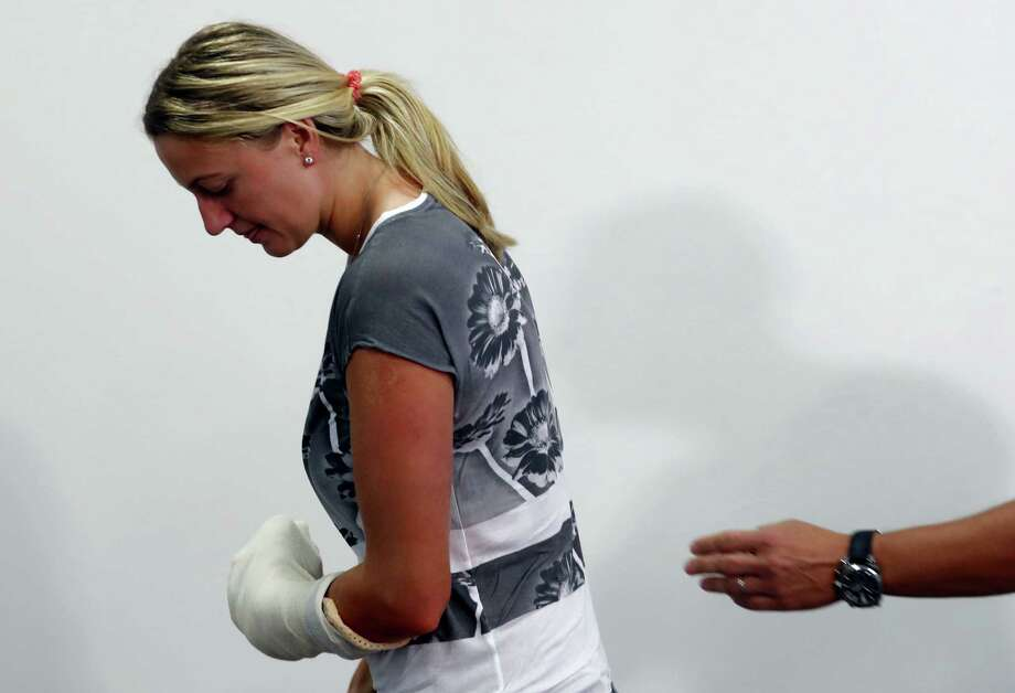In this Friday, Dec. 23, 2016 photo, Czech Republic's tennis player Petra Kvitova leaves after making a statement to the media in Prague, Czech Republic. Two-time Wimbledon champion Petra Kvitova is to decide by the week's end whether she will be available to play the French Open following a recovery from an attack by a knife-wielding intruder. Photo: AP Photo — Petr David Josek, File  / Copyright 2016 The Associated Press. All rights reserved.