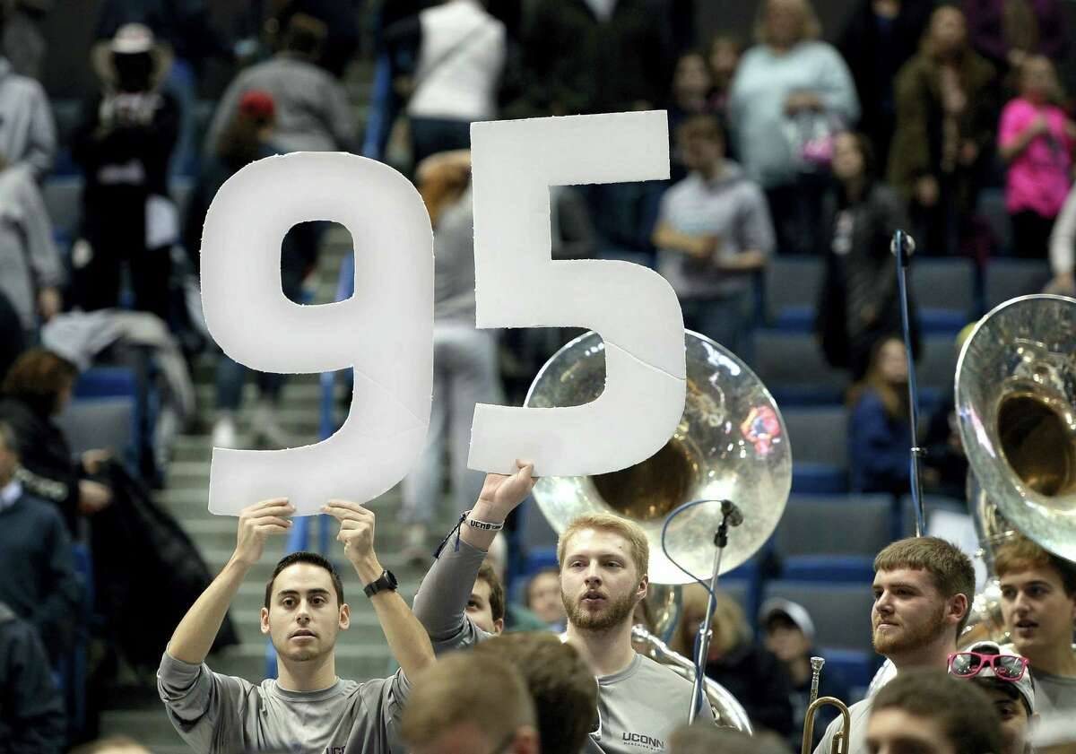 Members of the UConn band hold up the number 95 at the end of Saturday's game.