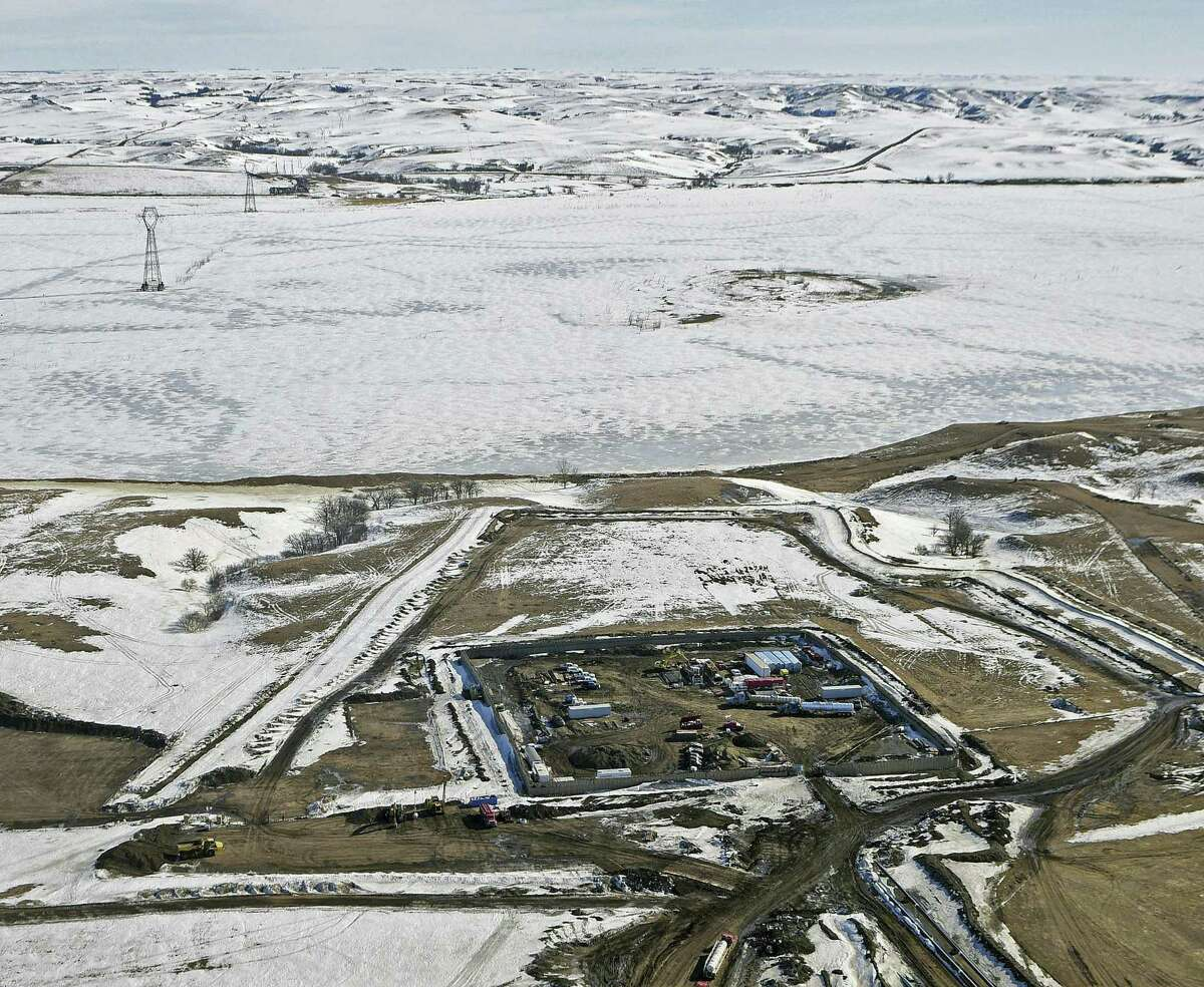 Tom Stromme/The Bismarck Tribune via AP, File This Feb. 13, 2017, aerial file photo, shows a site where the final phase of the Dakota Access pipeline is taking place with boring equipment routing the pipeline underground and across Lake Oahe to connect with the existing pipeline in Emmons County near Cannon Ball, N.D. Federal Judge James Boasberg on Tuesday, March 14 denied a request by the Standing Rock and Cheyenne River Sioux to stop oil from flowing while they appeal his earlier decision allowing pipeline construction to finish.