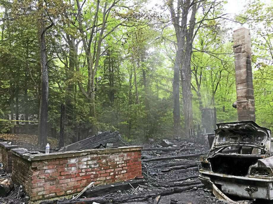 A cottage at 334 Norwood Road in Winsted was destroyed by fire Monday evening. A victim in the fire was treated for burns and remains in Waterbury Hospital. Photo: Ben Lambert — The Register Citizen