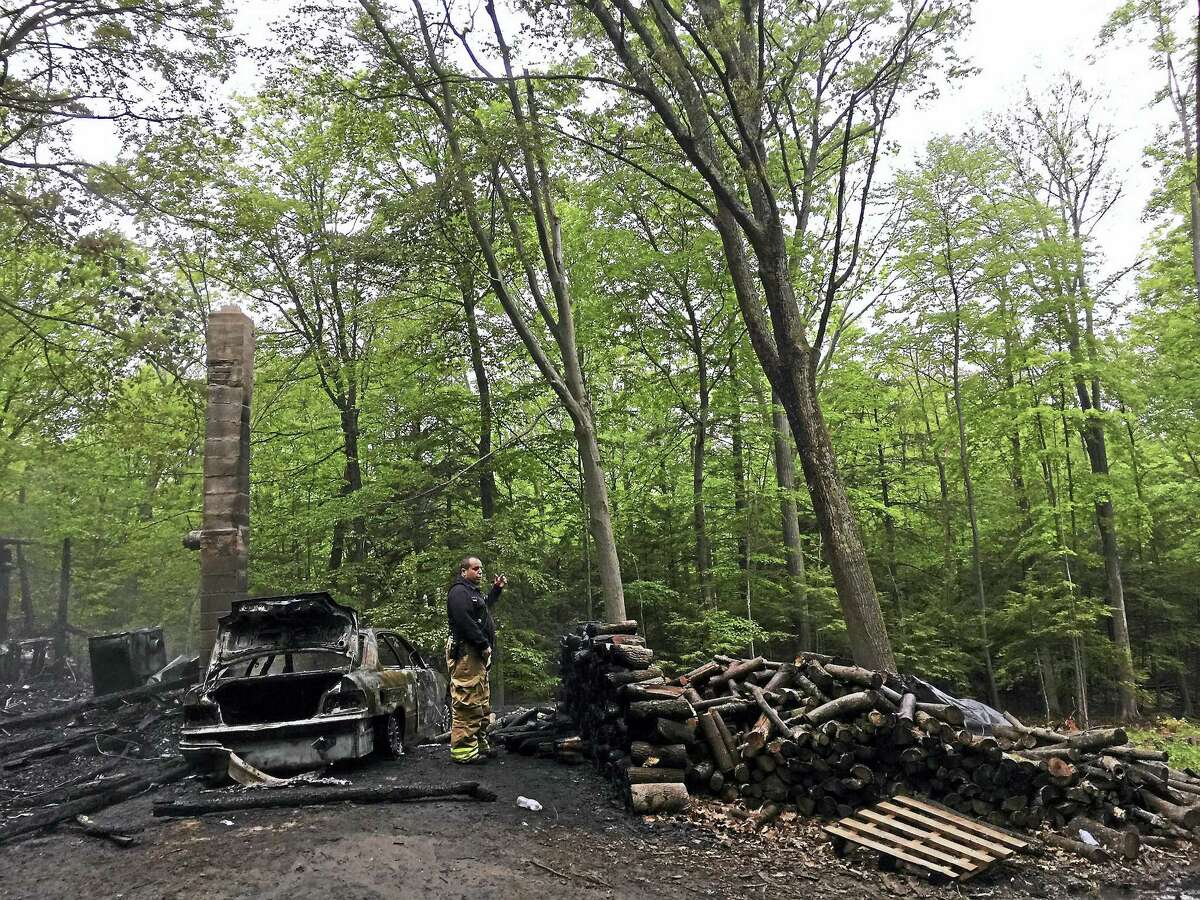 A cottage at 334 Norwood Road in Winsted was completely destroyed by a fire on Monday.