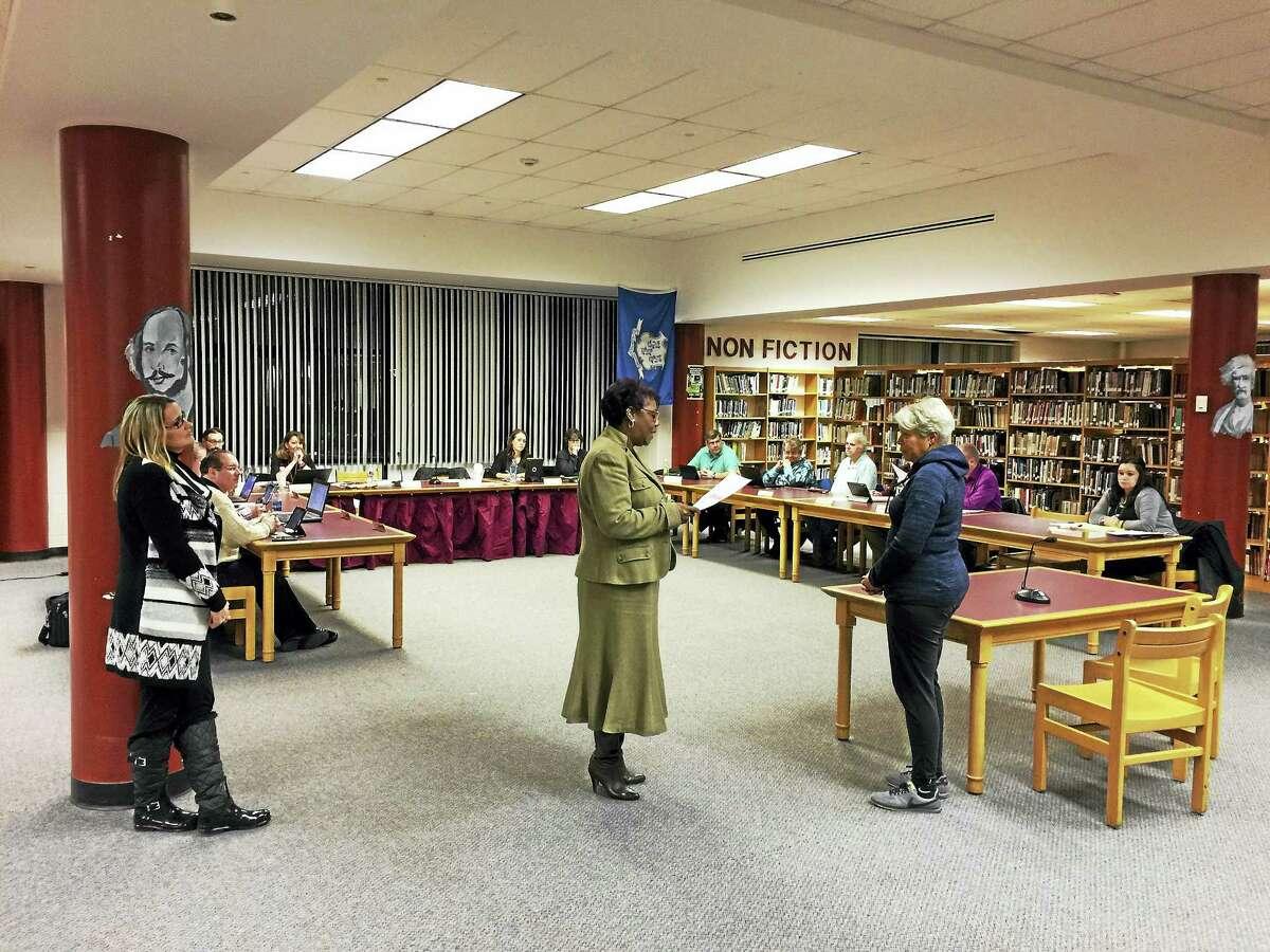 Ben Lambert — The Register Citizen Torrington teacher Janice Harrington, head of the Forbes Flyers program, was recognized at Wednesday's Board of Education meeting. Above, Superintendent Denise Clemons, center, speaks to Harrington, right, during the recognition.