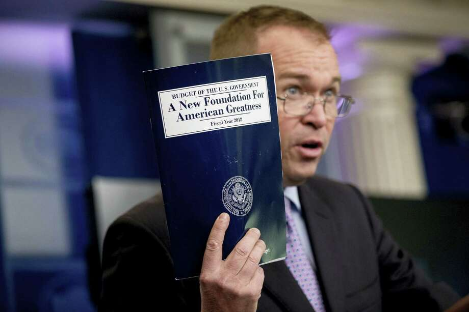 Budget Director Mick Mulvaney holds up a copy of President Donald Trump's proposed fiscal 2018 federal budget as he speaks to members of the media in the Press Briefing Room of the White House in Washington, Tuesday, May 23, 2017. Photo: AP Photo/Andrew Harnik   / Copyright 2017 The Associated Press. All rights reserved.
