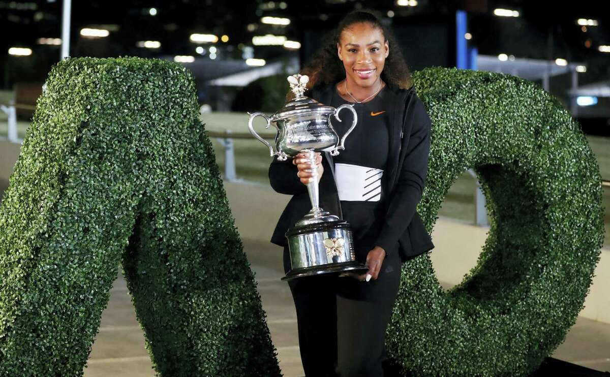 United States' Serena Williams poses with her trophy after defeating her sister Venus to win the women's singles final at the Australian Open tennis championships in Melbourne, Australia, Sunday, Jan. 29, 2017.