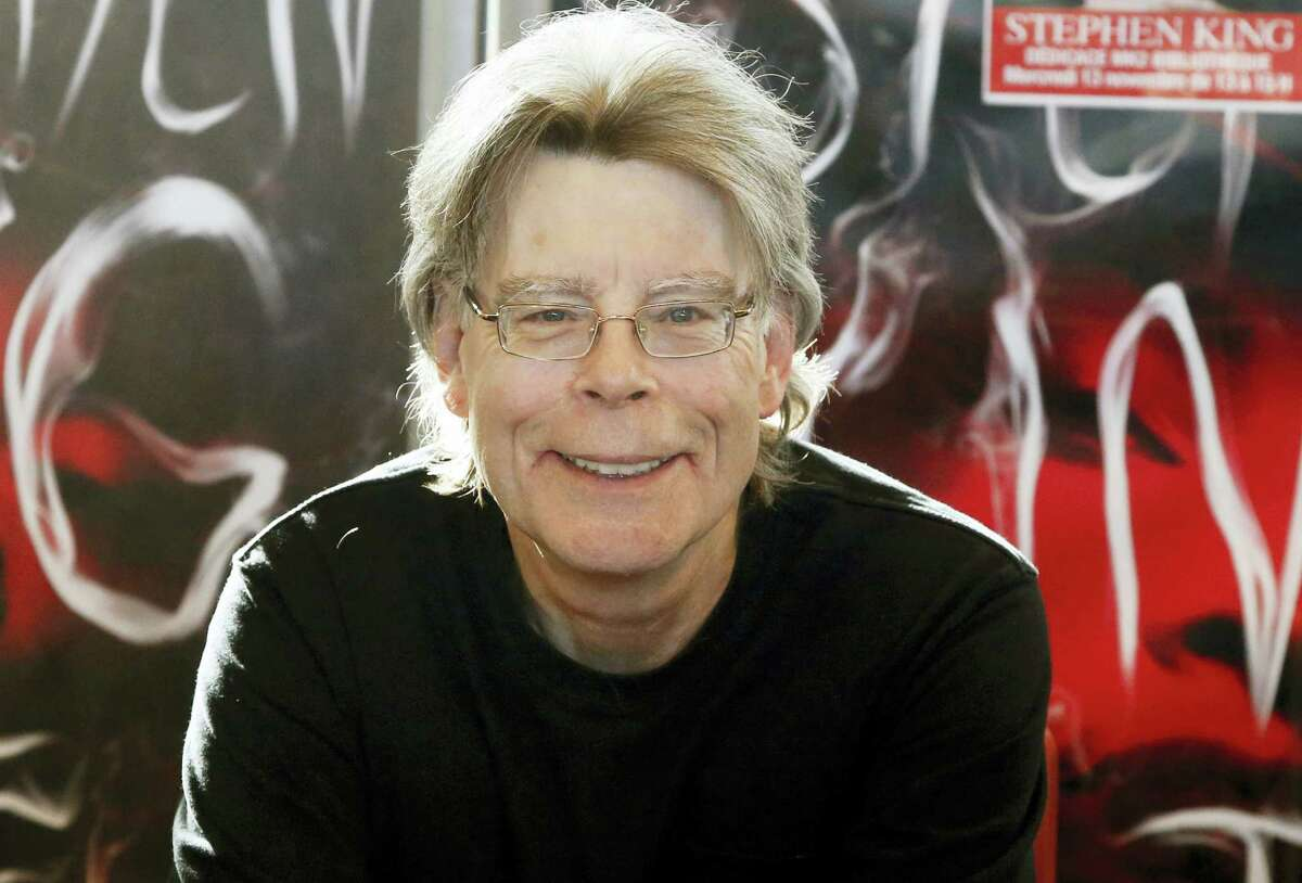 "In this Nov. 13, 2013, file photo, author Stephen King poses for the cameras, during a promotional tour in Paris. King wrote on Twitter on May 23, 2017, that Islamic State is a ""rogue cult"" and that the group's bombings will eventually lead to its undoing."