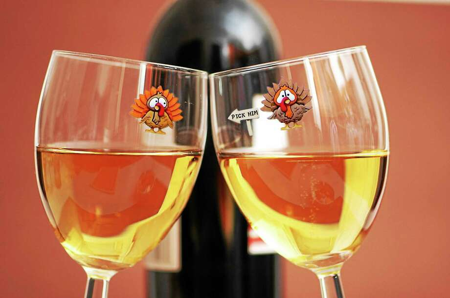 Two wine glasses and the bottle at background Photo: Digital First Media / Bigstock