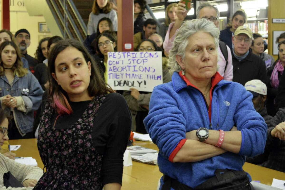 """""""Restrictions don't stop abortions. They make them deadly,"""" read one of the signs held up by the more than 300 people who attended Sen. Len Suzio's town hall meeting at the Russell Library to talk about the upcoming Legislative session."""