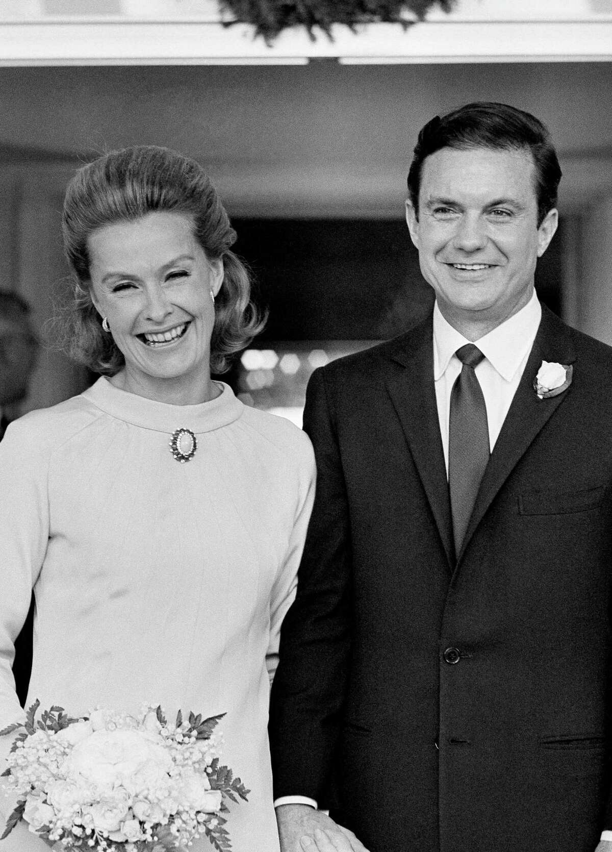 In this Dec. 21, 1966, file photo, actress Dina Merrill, left, and actor Cliff Robertson appear at their wedding at the palatial estate of her mother, cereal heiress Marjorie Meriwether Post, in Washington. Merrill, the rebellious heiress who defied her super-rich parents to become an actress, died Monday, May 22, 2017, at age 93.