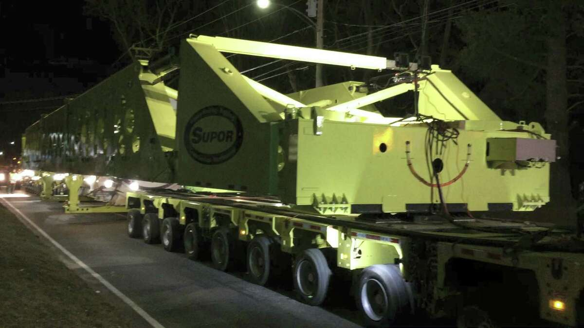 """The """"super load,"""" one of six planned to make their way to Oxford, travels past the intersection of Newfield Road and Winsted Road Monday evening in Torrington."""