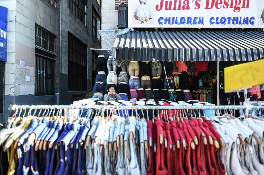 Clothes are displayed for sale on the street in Los Angeles. Photo: Pablo Unzueta — The Washington Post  / Pablo Unzueta for The Washington Post.