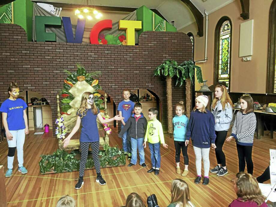 """""""Madagascar"""" cast members, from left, are Marguerite Bickford, Jordan Haggard, Gus Dekker (rear), Hoyt Boyden, Gavin Mechare, Madeline Mechare, Ellanor Karcheski, Elaine Dekker and Leah Drislane. The children are rehearsing for the musical's weekend of shows, set for March 31 and April 1-2. Photo: Contributed Photos - Falls Village Children's Theater"""