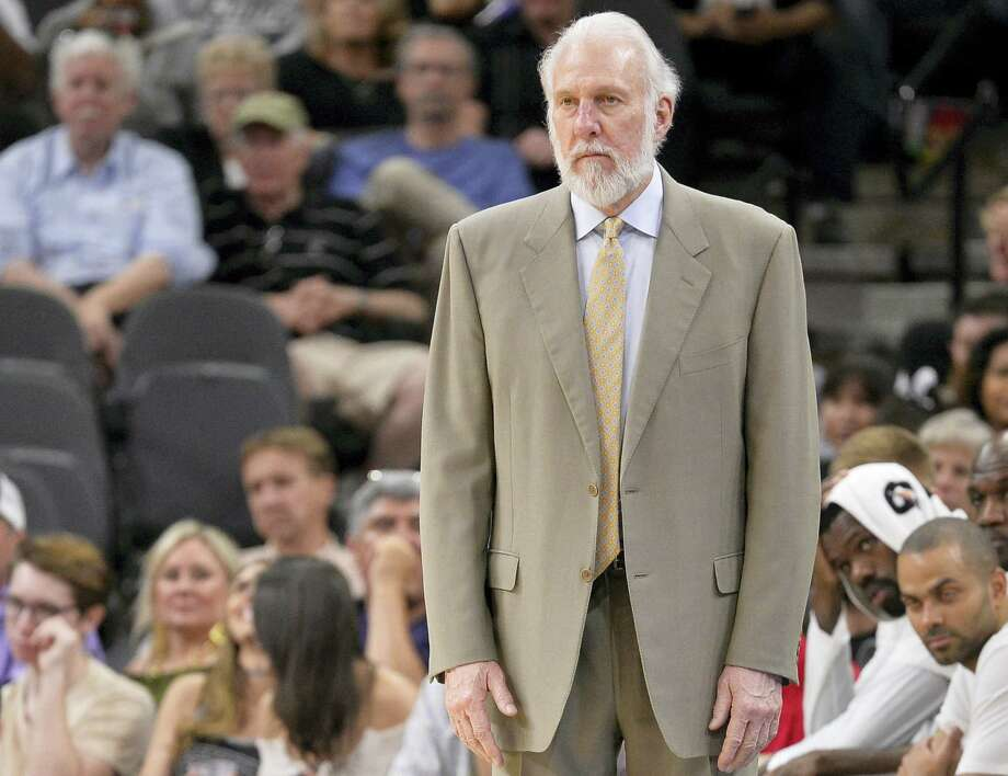 San Antonio Spurs head coach Gregg Popovich watches the second half of an NBA basketball game against the Sacramento Kings on March 19, 2017 in San Antonio. Photo: AP Photo — Darren Abate  / FR115 AP