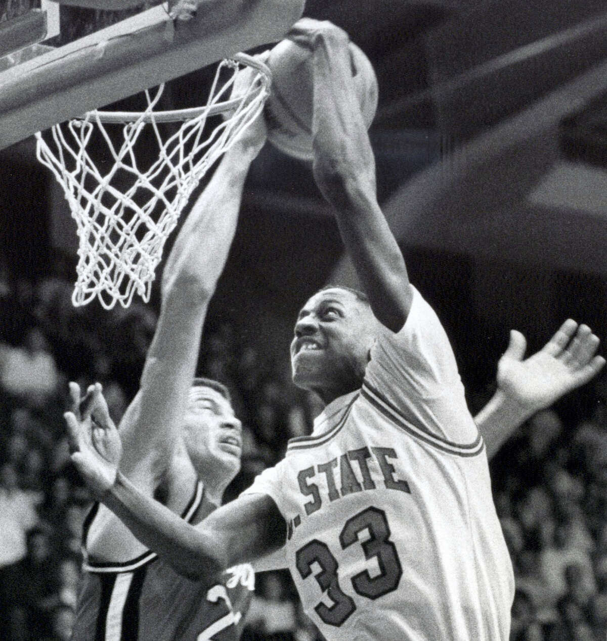 Charles Shackleford (33) battles against a Maryland player during a game in 1988. Shackleford, a North Carolina State basketball star in the 1980s who spent six seasons in the NBA, was found dead in his home on Friday in Kinston, N.C. He was 50.
