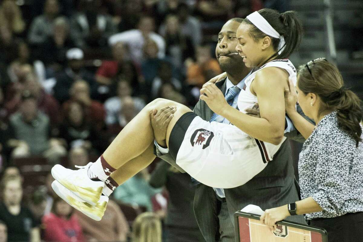 South Carolina guard Allisha Gray is carried off the court after an injury during a second-round game in the NCAA women's college basketball tournament against Arizona State on March 19, 2017 in Columbia, S.C. South Carolina won, 71-68.
