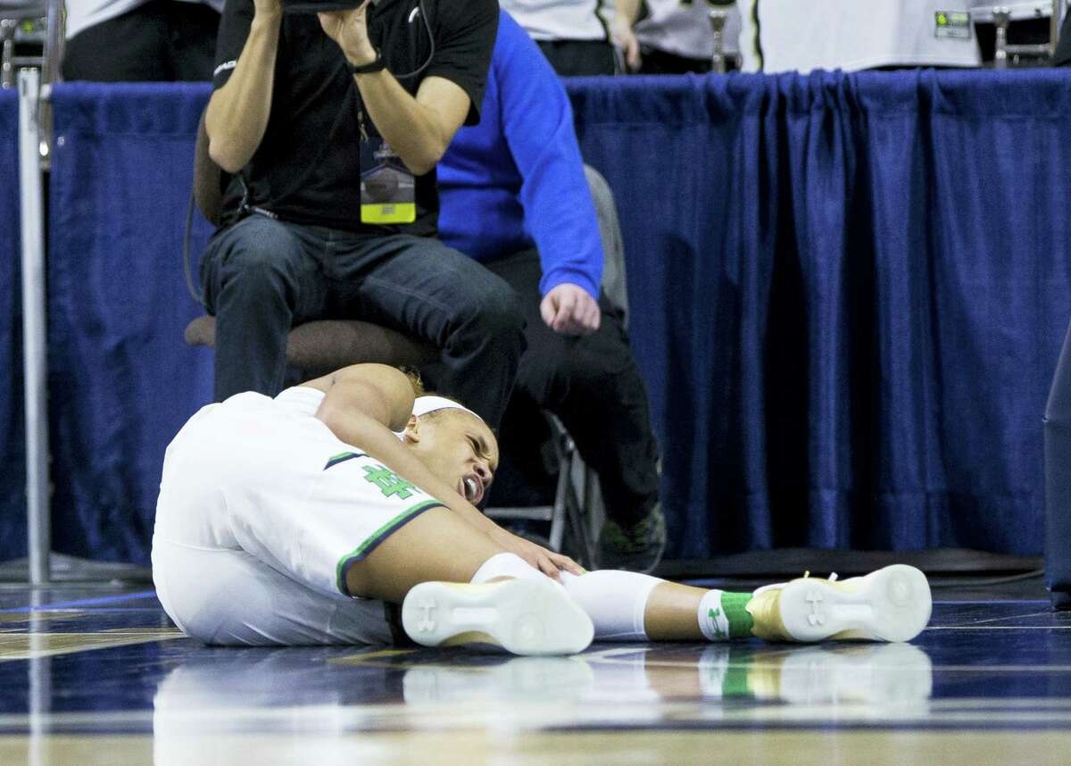 Notre Dame's Brianna Turner reacts to a knee injury during the first half of a second-round game against Purdue in the NCAA women's college basketball tournament on March 19, 2017 in South Bend, Ind.