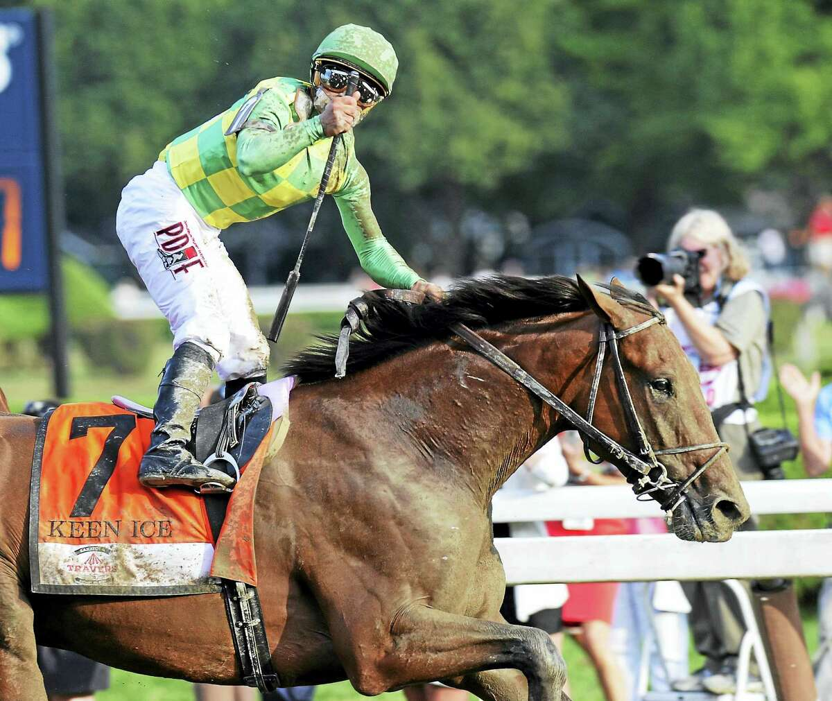Kavier Castellano celebrates after Keen Ice defeated Triple Crown winner American Pharoah to win the Travers Stakes in 2015.