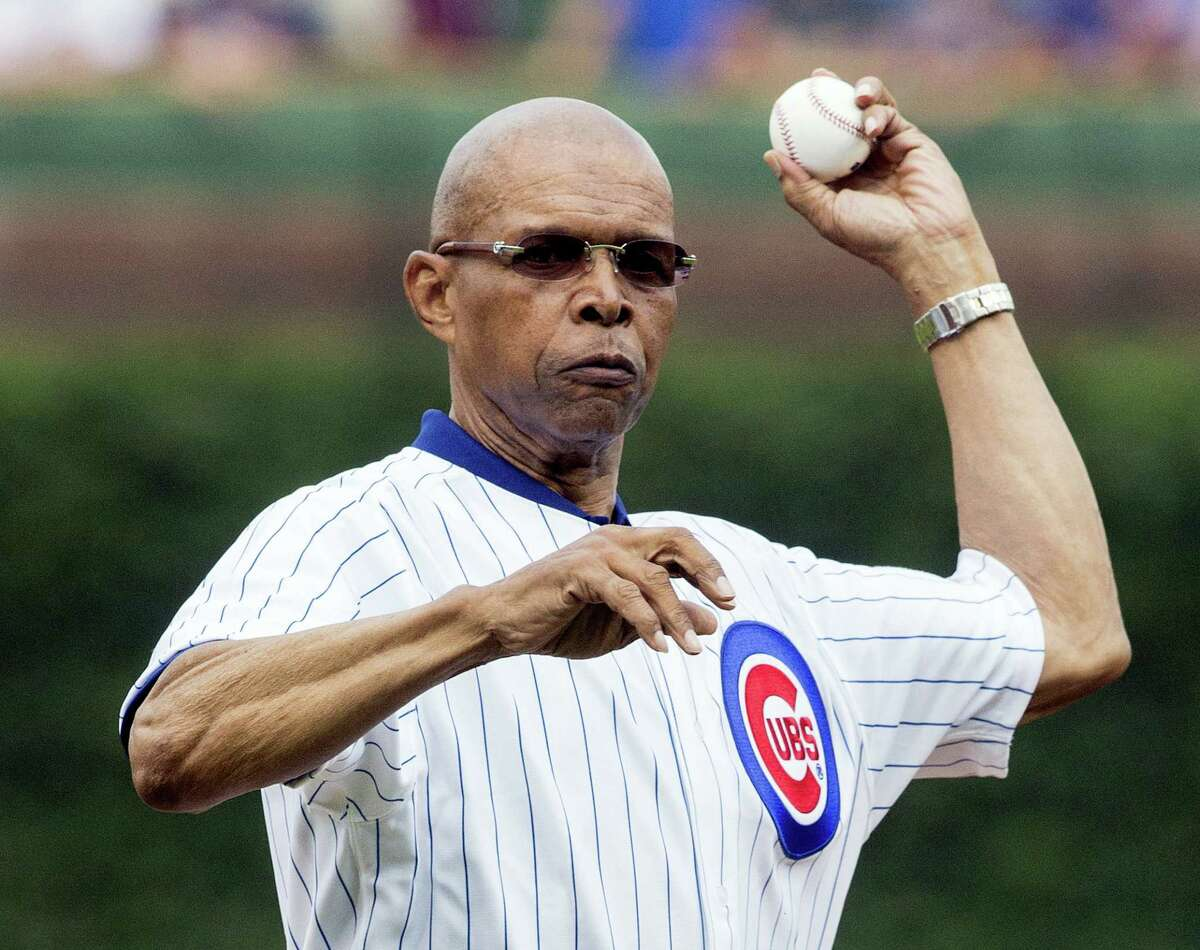 Former Chicago Bears NFL football player Gale Sayers throws out a ceremonial first pitch before a baseball game between the Chicago Cubs and Atlanta Braves in 2014 in Chicago.