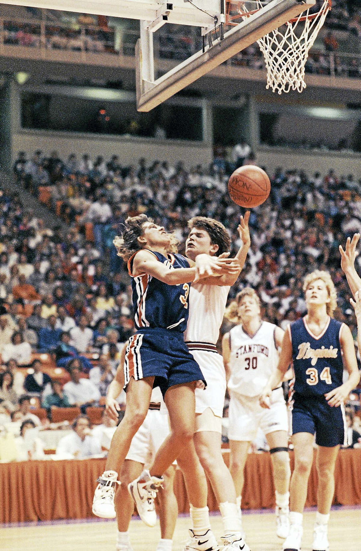 Virginia's Tammi Reiss, left, collides with a Stanford player during the 1990 national semifinal game.