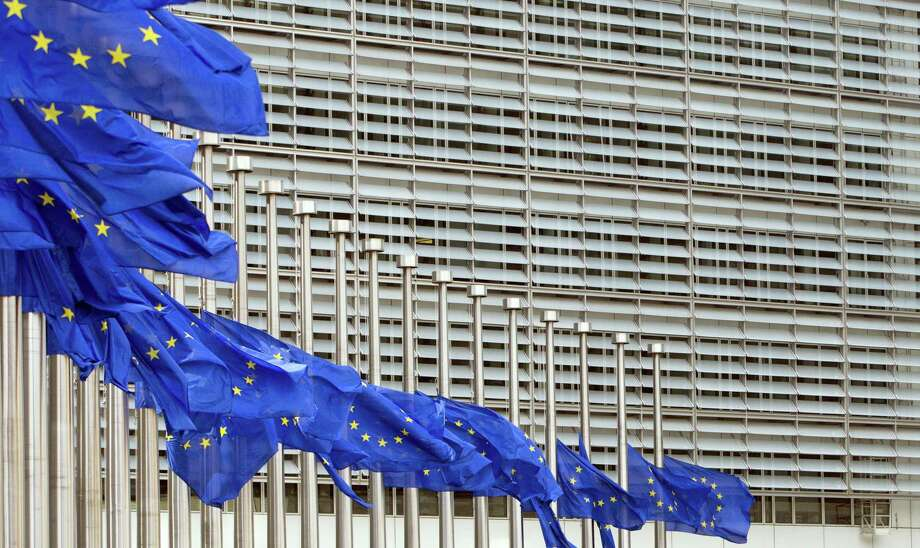 European Union flags blow in the wind at half-staff outside EU headquarters in Brussels on Tuesday, May 23, 2017. The flags were set at half-staff to remember those killed and injured in the attack at an Ariana Grande concert in Manchester on Monday night.  (AP Photo/Virginia Mayo) Photo: AP / Copyright 2017 The Associated Press. All rights reserved.