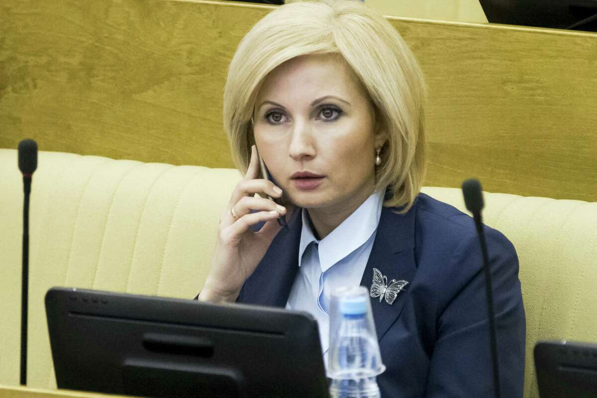 Russian lawmaker Olga Batalina, one of the bill's co-authors, who rejected suggestions that the bill would sow impunity for those who beat up their families, speaks on a phone at the State Duma (lower parliament house) in Moscow, Russia, Friday, Jan. 27, 2017. The State Duma voted 380-3 Friday to eliminate criminal liability for battery on family members that doesn't cause bodily harm, making it punishable by a fine or a 15-day day arrest.