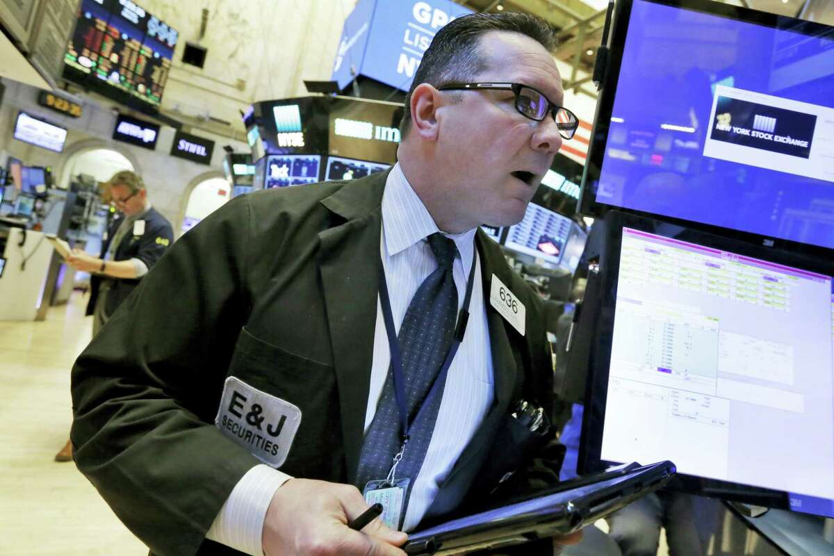 Trader Edward Curran works on the floor of the New York Stock Exchange Monday.