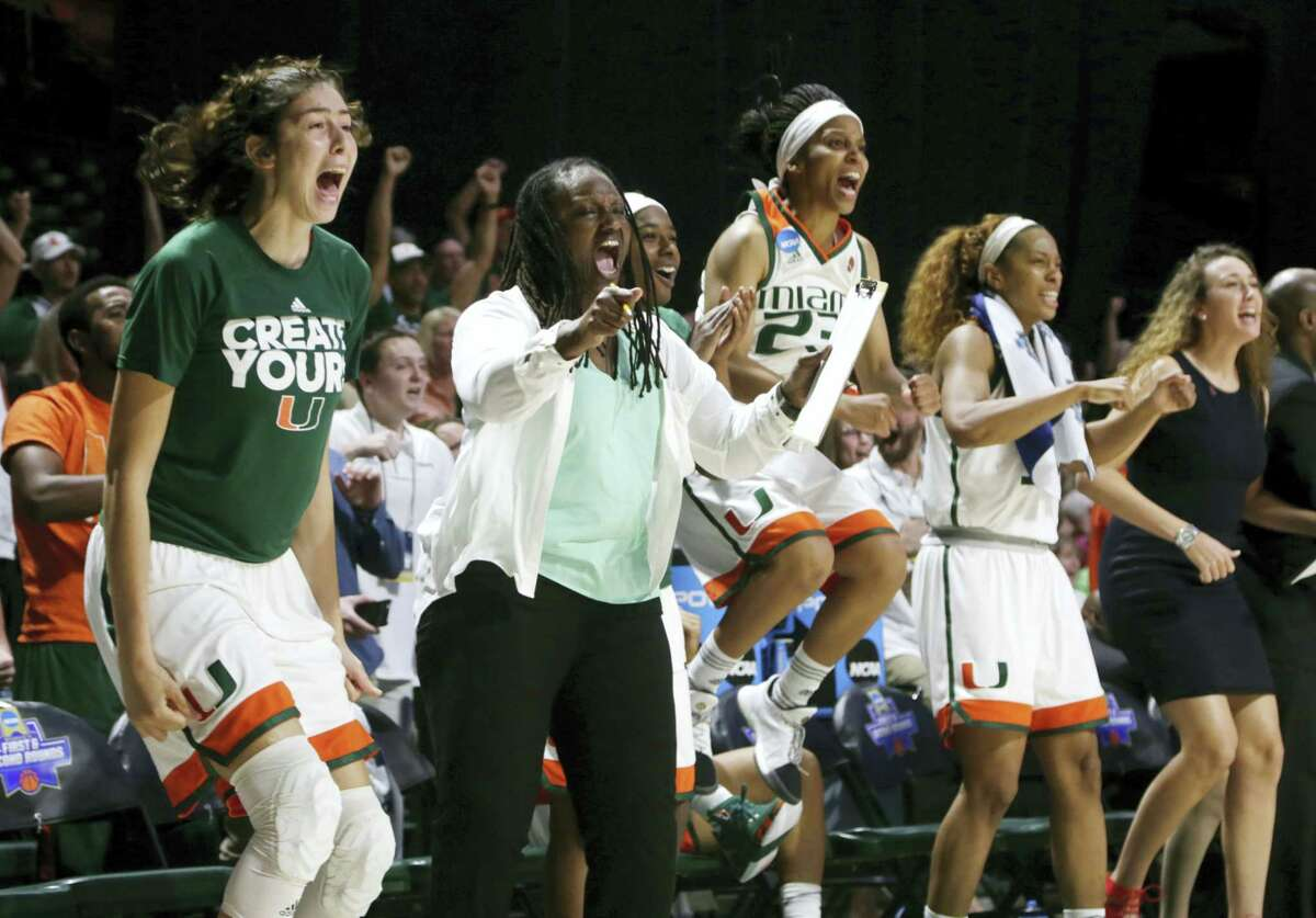 Players on the Miami bench cheer during the second half of their win over Florida Gulf Coast on Saturday.