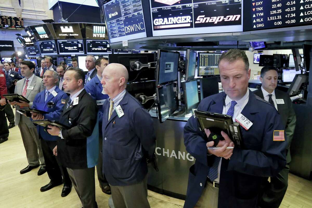 Traders on the floor of the New York Stock Exchange Tuesday observe a moment of silence in the wake of the attack in Manchester, England.