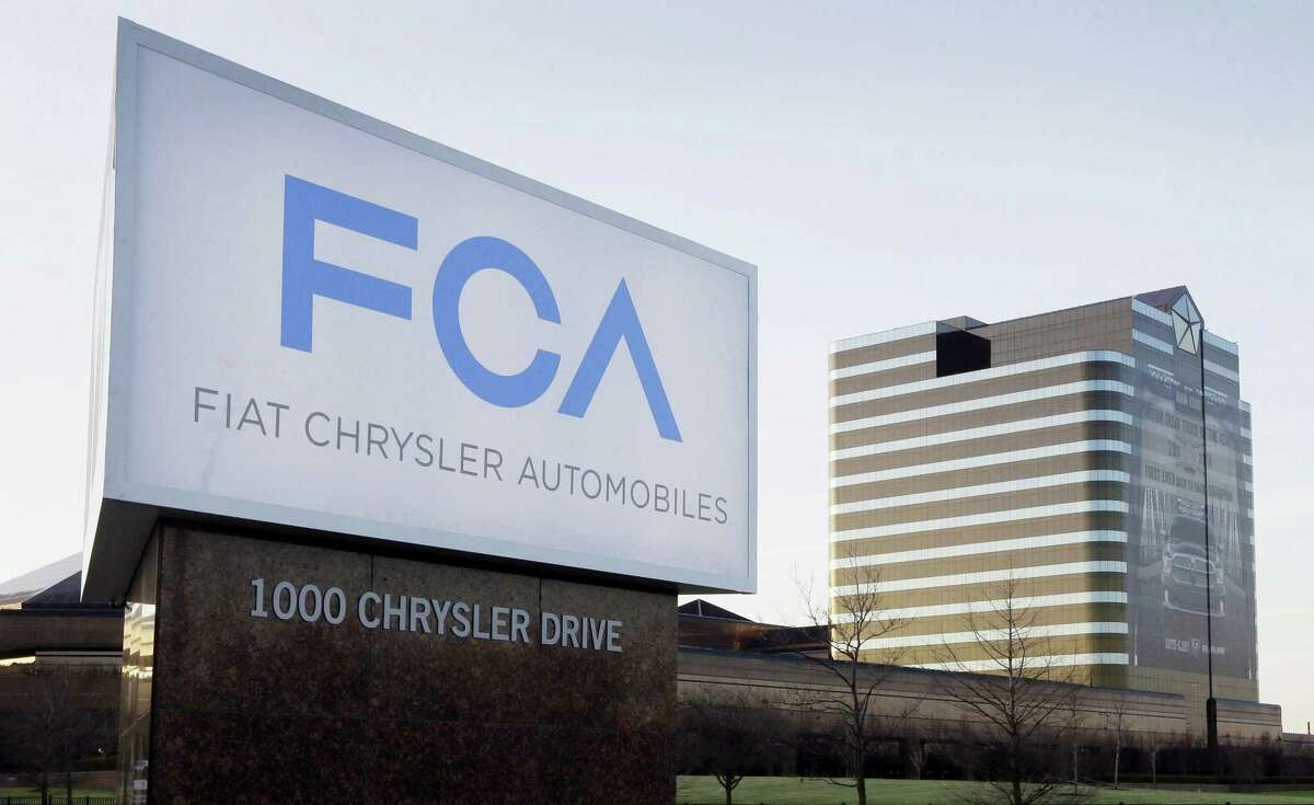FILE - This Tuesday, May 6, 2014, file photo shows a sign outside Fiat Chrysler Automobiles world headquarters in Auburn Hills, Mich. In a lawsuit filed Tuesday, May 23, 2017, the U.S. government is suing Fiat Chrysler, alleging that some diesel pickup trucks and Jeeps cheat on emissions tests.