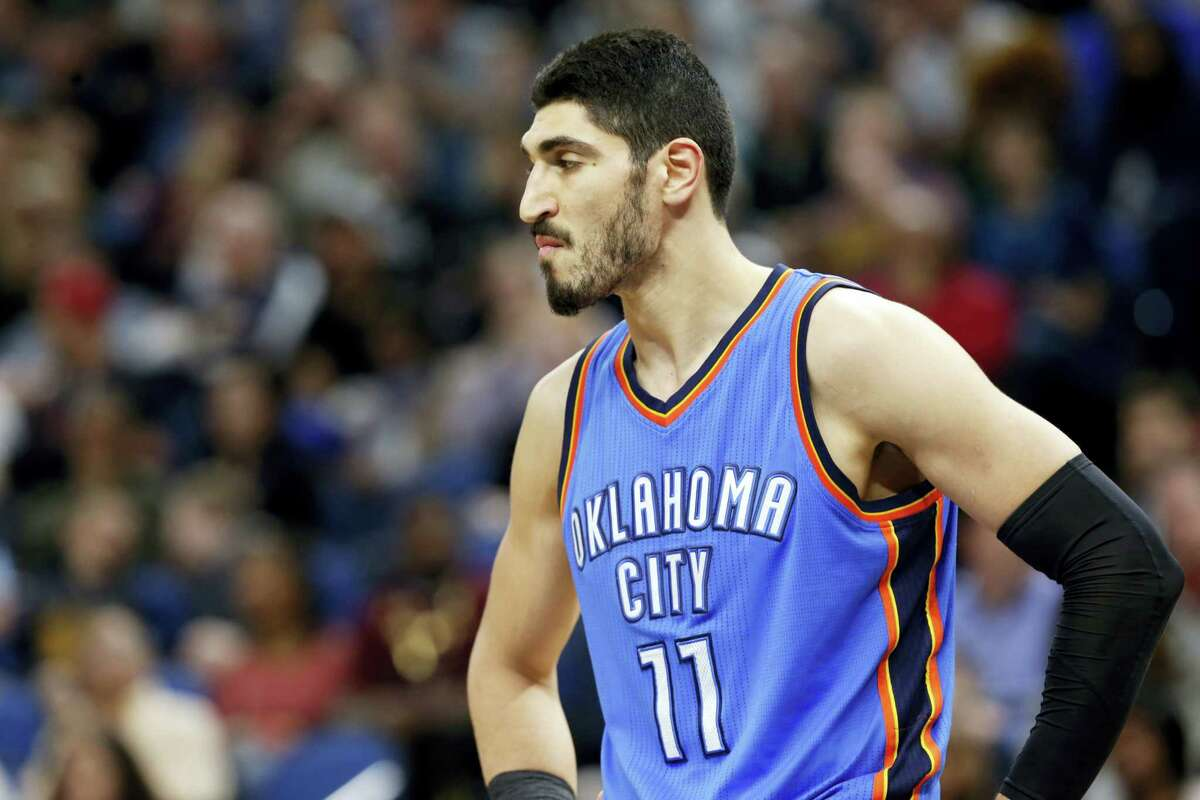 In this April 11, 2017 photo, Oklahoma City Thunder's Enes Kanter, of Turkey, looks on during a break in the second half of an NBA basketball game against the Minnesota Timberwolves in Minneapolis. Kanter is returning to the United States after being detained in a Romanian airport. Kanter, who is from Turkey, said in a video on May 20, 2017 on his Twitter account that the Turkish embassy canceled his passport and he'd been detained for several hours at a Romanian airport.
