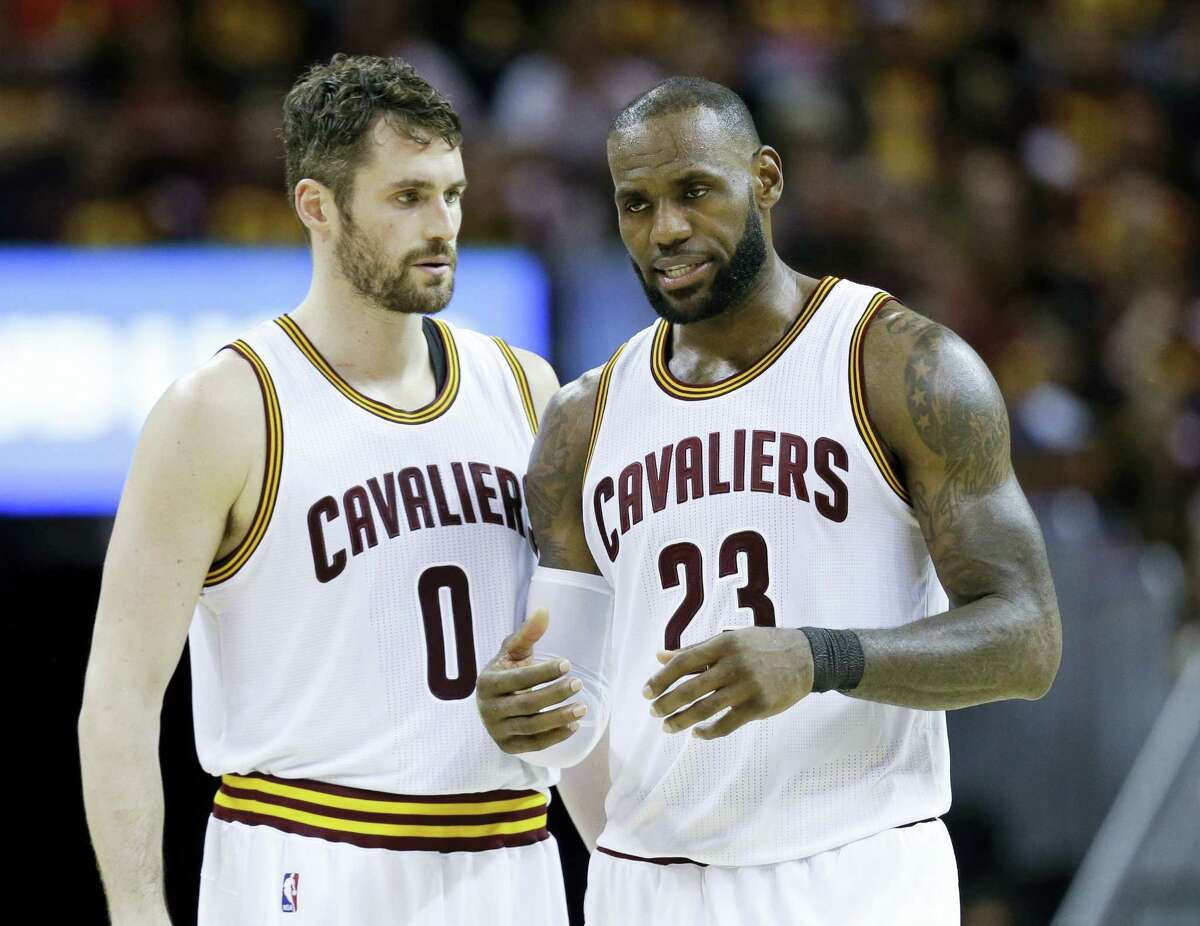Cleveland Cavaliers' LeBron James (23) talks with Kevin Love (0) against the Boston Celtics during the second half of Game 3 of the NBA basketball Eastern Conference finals on May 21, 2017 in Cleveland. The Celtics won 111-108.