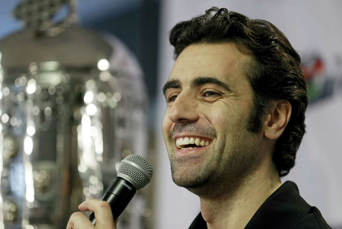 In this Dec. 19, 2013 photo, Dario Franchitti of Scotland answers a question during his first public appearance since a crash ended his IndyCar career during a press conference in Indianapolis.