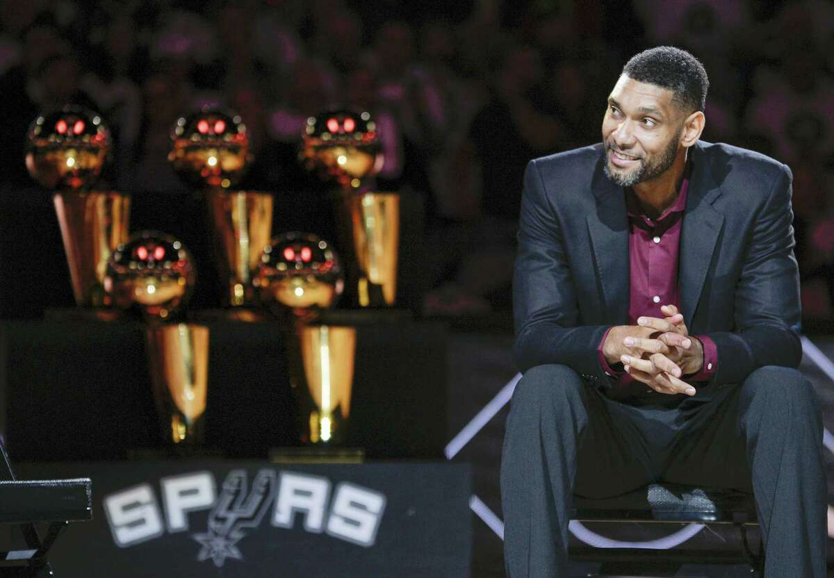 In this Dec. 18, 2016 photo, San Antonio Spurs' Tim Duncan listens while special guests speak about him during his jersey retirement ceremony, in San Antonio. There was a mad scramble at the Spurs practice during the Western Conference finals, a flurry of activity to position cameras and get recording devices ready to document essentially what was the sighting of a white whale. Tim Duncan, the NBA's most reclusive star, had apparently accepted a request to speak publicly for the first time since quietly retiring in the offseason.